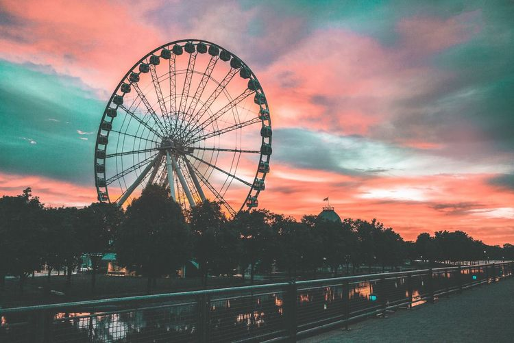Amusement Park Ride Amusement Park Sky Ferris Wheel Arts Culture And Entertainment Sunset Cloud - Sky Nature Illuminated Architecture Built Structure Dusk Outdoors Water No People Low Angle View Carnival Travel Travel Destinations Dramatic Sky HUAWEI Photo Award: After Dark