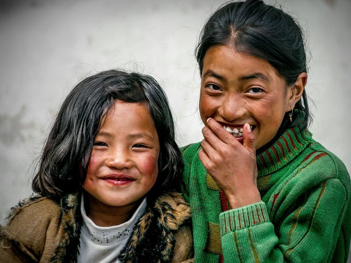 Smile of the Year EyeEm Best Shots Arunachal Pradesh Warm Clothing Smile Posing For The Camera Tawang India Asian  Portrait Portrait Photography Portrait Of A Girl Siblings Sisters Girls Portraits Of EyeEm Friendship Portrait Bonding Togetherness Smiling Young Women Headshot Looking At Camera Happiness Cheerful Children Fur Coat EyeEmNewHere Capture Tomorrow Moments Of Happiness It's About The Journey