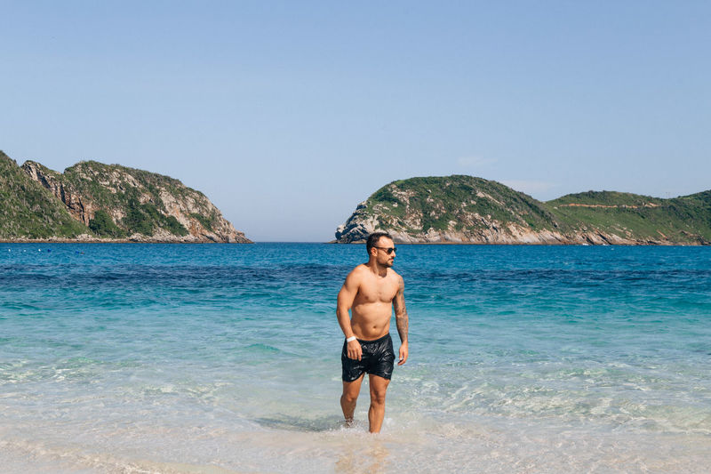 Sea Water Shirtless Sky Beach Land Nature Beauty In Nature Standing Leisure Activity One Person Day Mountain Clear Sky Scenics - Nature Lifestyles Men Copy Space Trip Outdoors