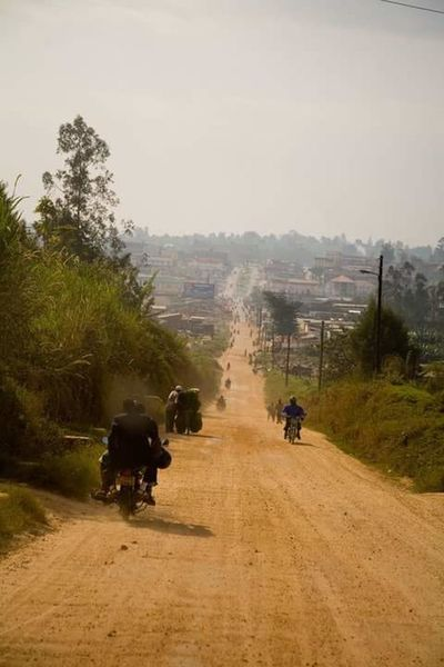 Ugandan Photographer Uganda  Riding To Work Road Into Town Dusty Road Motorcycles Fort Portal