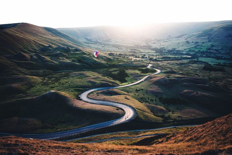 Paragliding over Mam Tor during sunset Britain Peak District  Landscape Environment Mountain Tranquility Tranquil Scene Scenics - Nature Nature Day Beauty In Nature Sky High Angle View No People Non-urban Scene Plant Land Agriculture Outdoors Road Idyllic Growth