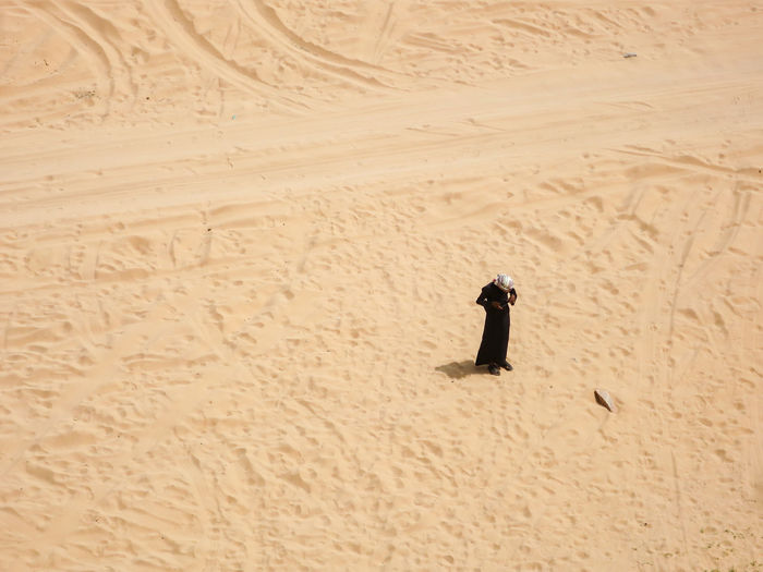 Adventure Creativity Desert Exploration Full Frame History Lone Figure Lone Figure Lone Boy On The Beach Lone Figure On Beach Mountain Physical Geography Sand Tracks In The Sand Wave Pattern