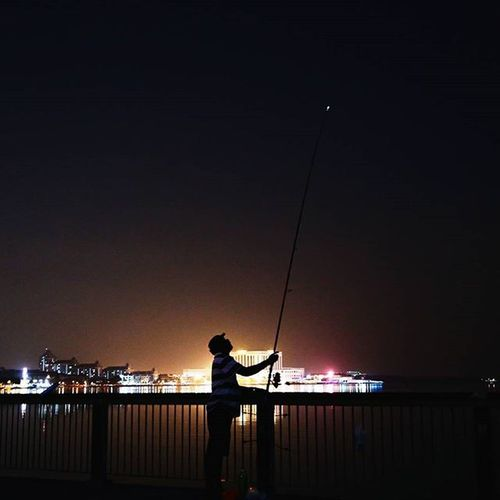 """How fragile we are, between the good moments."" — Jane Hirshfield Silhouette Fisherman Lights Nightphotography"
