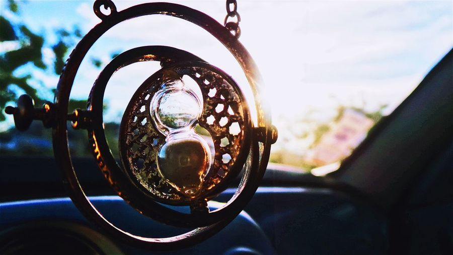 Close-up of hourglass hanging in car
