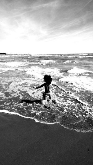 Sea Beach Water One Person Horizon Over Water Outdoors Vacations Sand Beauty In Nature Romagnamia Ravenna Romagna Romagna I ❤U! CoyaBeach foolish Childhood Child Children Photography Waves Waving Waves Sand
