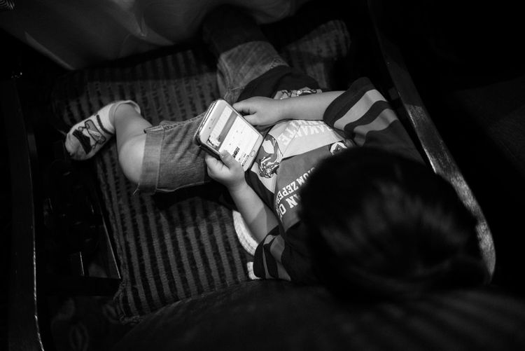Enjoy my game....by leica 28 summilux High Angle View Child Captured The Moment Blackandwhitephoto Leisure Activity Black And White Photography Happiness Gamer Gaming Time