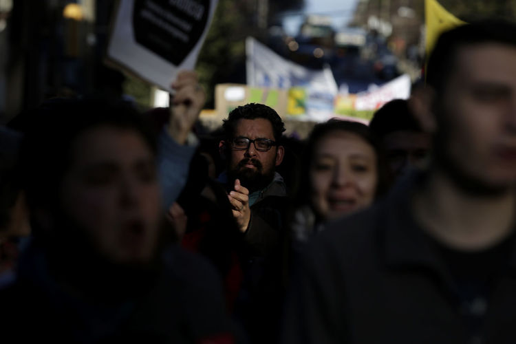 Portrait of man amidst crowd during protest