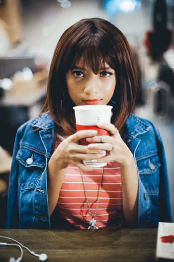 Close-Up Of Woman Drinking Coffee