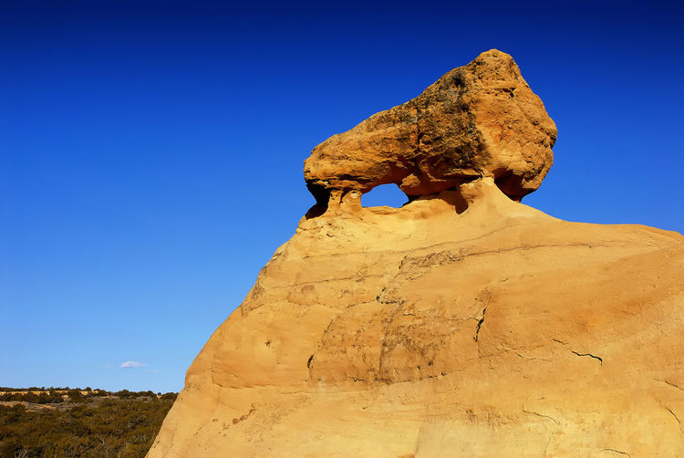 Beauty In Nature Blue Brown Clear Sky Day Landscape Low Angle View Nature No People Non-urban Scene Outdoors Remote Rock Rock - Object Rock Formation Scenics Sky Sunlight Sunny Tranquil Scene Tranquility