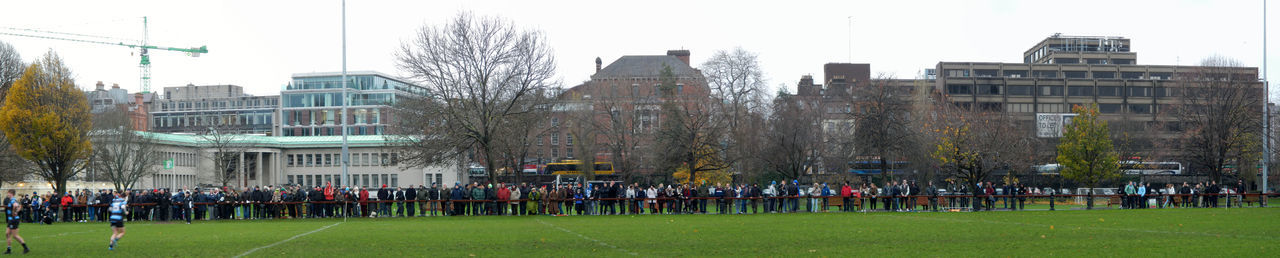 Watching a rugby match City Skyline Crowd Line Of People Rugby Field Rugby Pitch Sport TCD Trinity College Dublin Watching