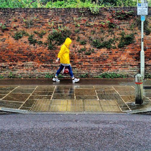 Gloucester Pitt Street Street Woman Walking Streetphotography Rainy Raincoat Brickwall Sidewalk