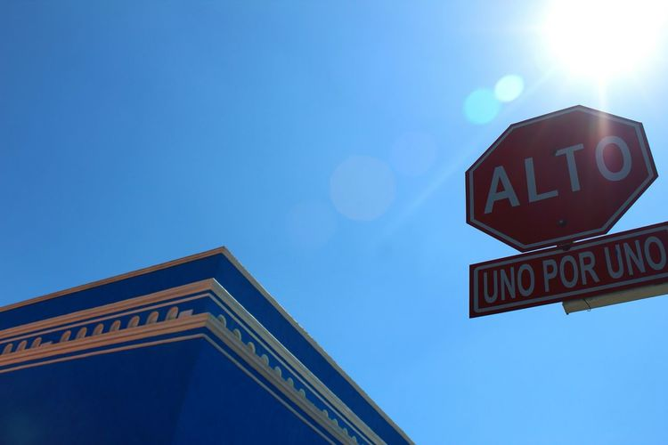 One by one Low Angle View Sky Communication Road Sign Clear Sky Text Outdoors No People Day Close-up This Is México Light The City Light Mexico Puebla Atlixo Streetphotography Urban Going Places Illuminated