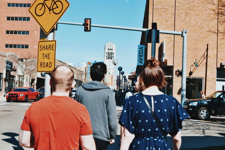 Rear view of people on city street