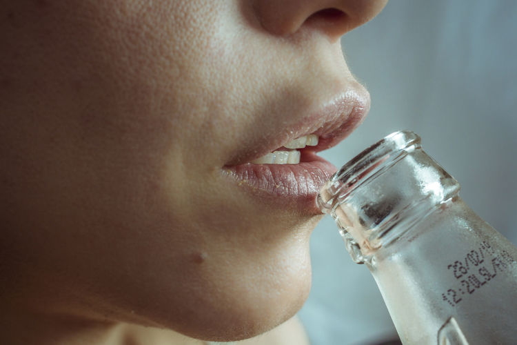 Close-Up Of A Woman Drinking Glass