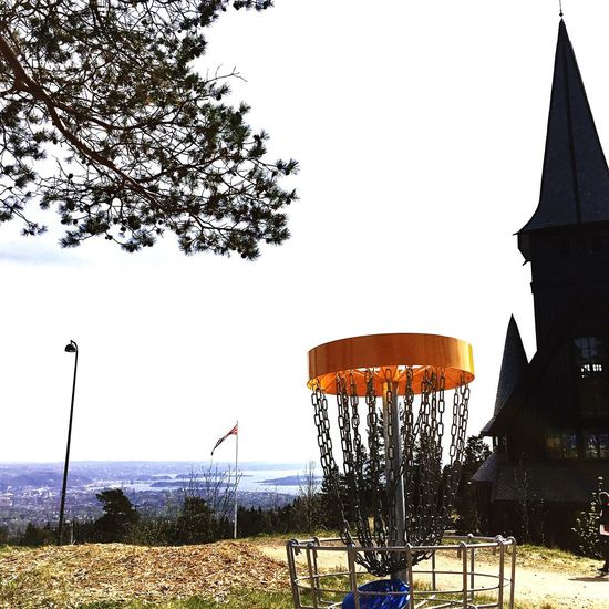 Tree Built Structure Sky Architecture Outdoors Clear Sky Building Exterior No People Low Angle View Day Nature Discgolfbasket Innovadiscgolf Chapel Flag Holmenkollen Springtime