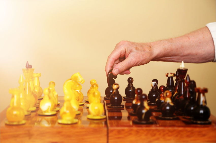 Playing chess Adult Amber Board Game Chess Chess Board Colorful Hand Indoors  Light Man Move Old Play Playing Strategy Sun Warm Win EyeEmNewHere