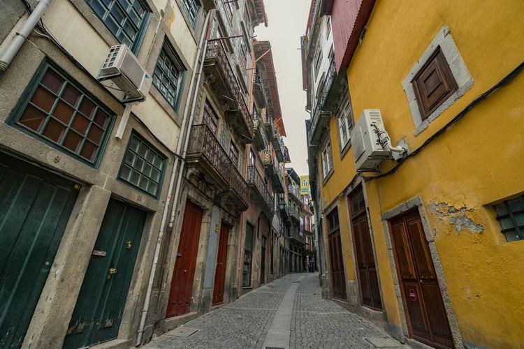 Narrow street between residential buildings