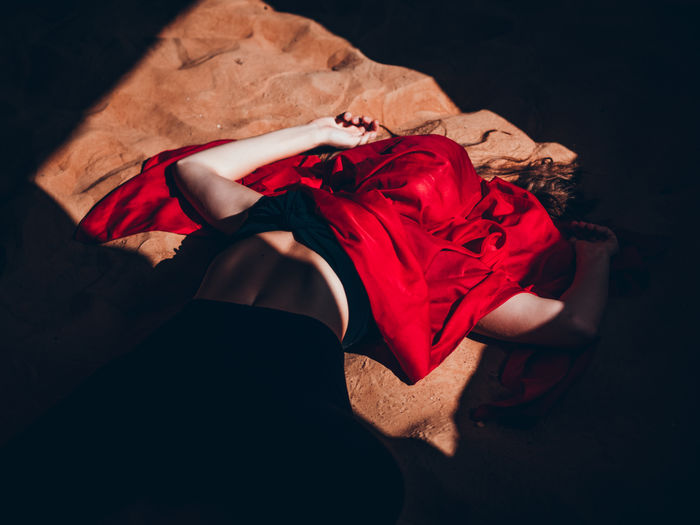 High angle view of woman lying on bed