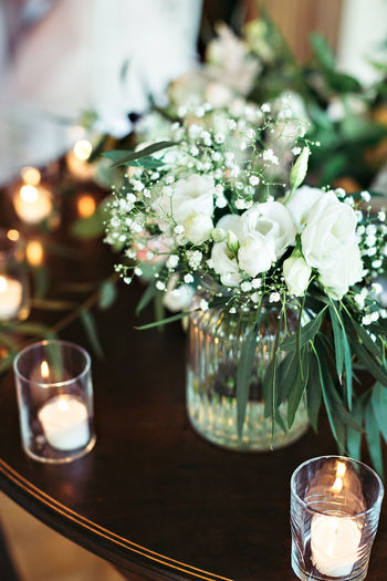 Bouquet Candle Close-up Drinking Glass Flame Flower Flower Head Focus On Foreground Fragility Freshness Illuminated Indoors  Lighting Equipment Nature Night No People Table Tea Light Vase Wineglass