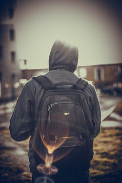 Architecture Backpack Building Exterior City Day Jacket Lifestyles Men One Person Outdoors People Real People Rear View Sky Standing Young Adult