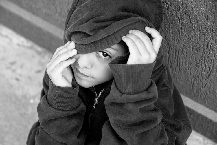Portrait of boy wearing hood