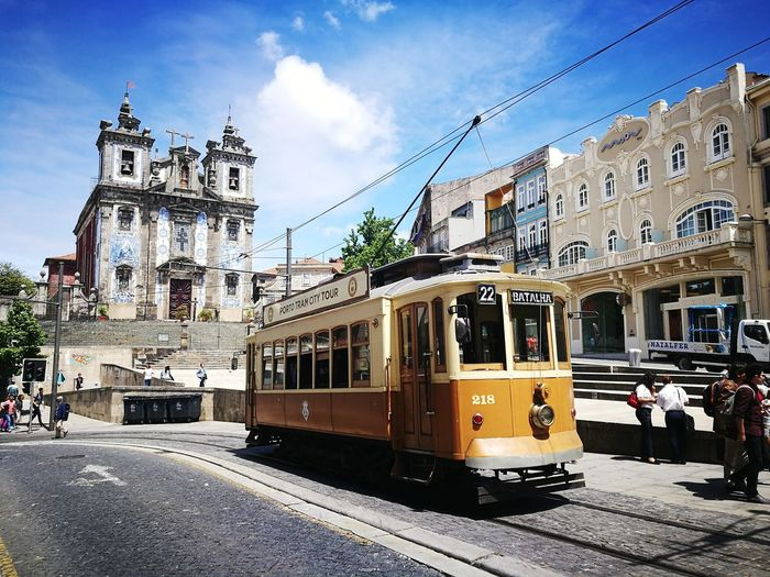 Railroad Track Porto Portugal 🇵🇹 Public Transportation Sky Incidental People Mode Of Transport Architecture Travel Destinations Train - Vehicle Building Exterior Cloud - Sky Day Porto Portugal Love Travelling