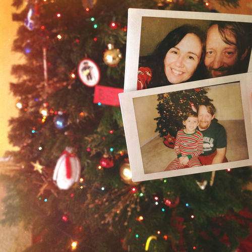 Christmas Christmas Lights Holiday Tradition Tree Celebration Christmas Decoration Decoration Family Happiness Instant Photos Looking At Camera Parents And Child Portrait Positive Emotion Real People Smiling Togetherness Vintage