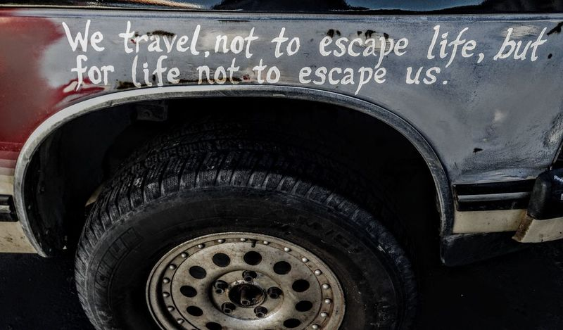 Traveler Tire Close-up No People Day Outdoors Words Words Of Wisdom... Words To Live By  Letters Phrase Anonomous Beat Up Weathered Wood Gypsy Soul Transportation On The Road Action Object Truck Vehicle