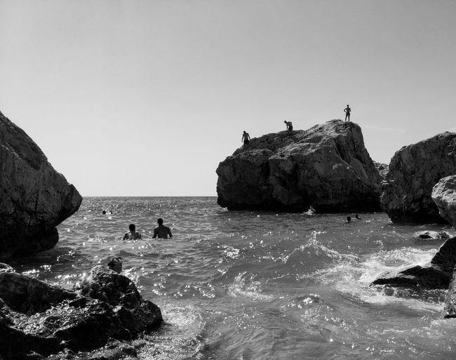 People on Kathisma beach on Lefkada Lefkada, Greece Silhouette Beach Beauty In Nature Black And White Cliff Kathisma Beach Nature Outdoors Rock Rock - Object Rock Formation Scenics Sea Tranquility Water