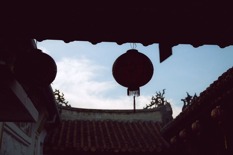 Low angle view of lantern against sky