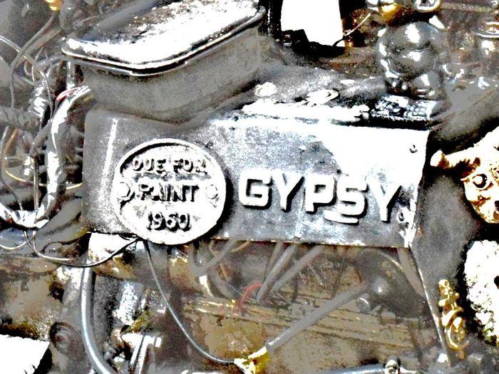 Black. Metallic. Car Engine. Part Of. Trike. Motorcycle. Car. Train. Gypsy Tag. Lettering. Art. Oddball. Unusual. Outdoors Text Transportation Western Script
