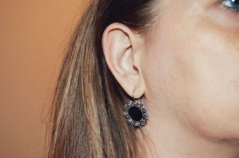 Close-up woman wearing earring