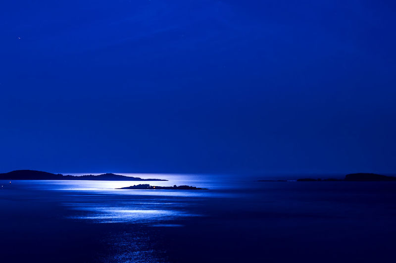 Scenic view of mediterranean sea against clear blue sky at night
