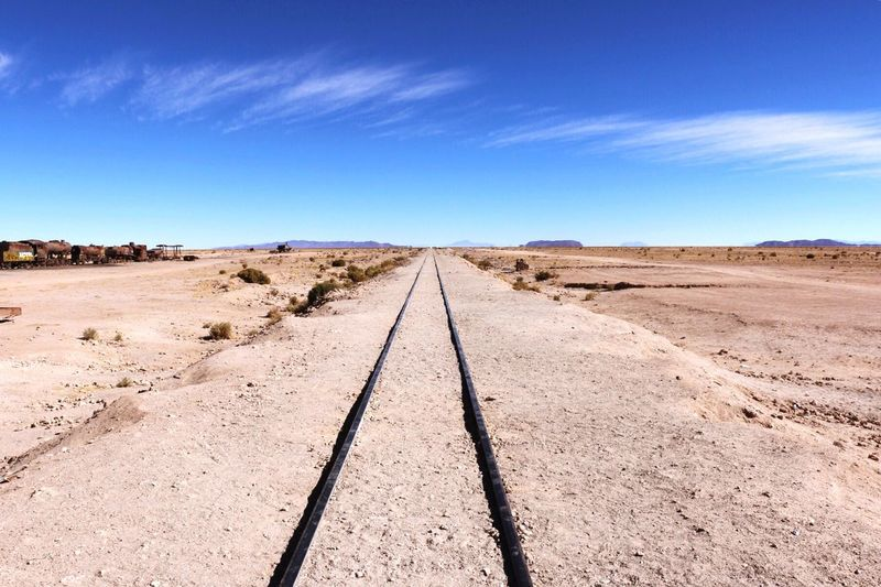 Train tracks outside Uyuni, Salt Flats in Bolivia. Blue Sky Train Tracks Scenery Salt Flats Train Landscape Remote Barren Scenics First Eyeem Photo Salar De Uyuni Bolivia Beautiful