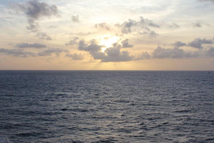 Caribbean Sunrise Sky Sea Water Horizon Cloud - Sky Horizon Over Water Tranquility Beauty In Nature Nature Scenics - Nature Waterfront Tranquil Scene Sunset Idyllic Freedom No People Remote Seascape Rippled Outdoors Caribbean Sunrise