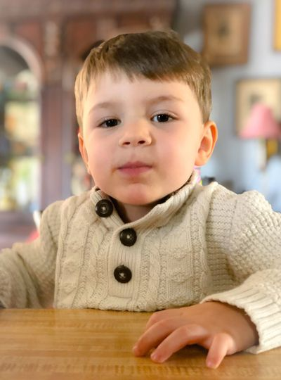 Portrait of cute boy at table