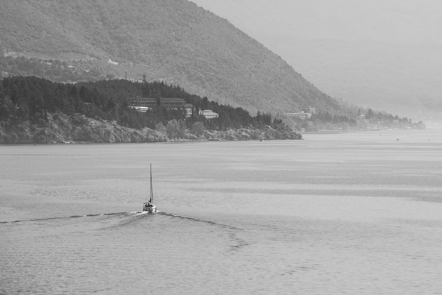 Balkan Lakeview Traveling Beauty In Nature Blackandwhite Boat Day Lake Lake View Lakeshore Landscape Monochrome Mountain Nature No People Outdoors Sail Boat Scenics Shore Sky Tranquil Scene Tranquility Travel Destinations Tree Water