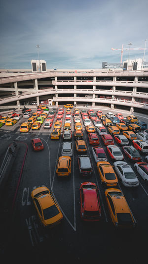 High angle view of cars in city against sky
