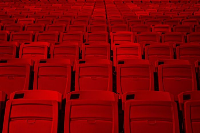 FULL FRAME SHOT OF RED SEATS IN ROW