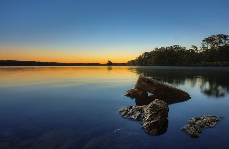 Sunrise at Loch Raven Water Reflection Tranquil Scene Lake Tranquility Scenics Nature Beauty In Nature Tree Clear Sky Outdoors Sunset Blue No People Sky Day