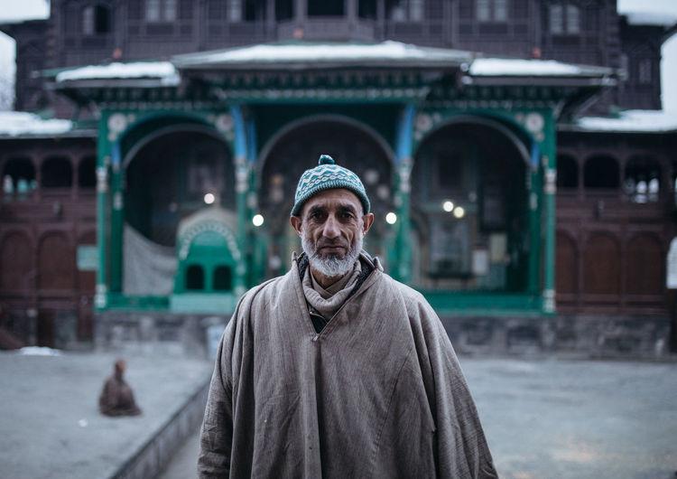 Portrait of man against built structure