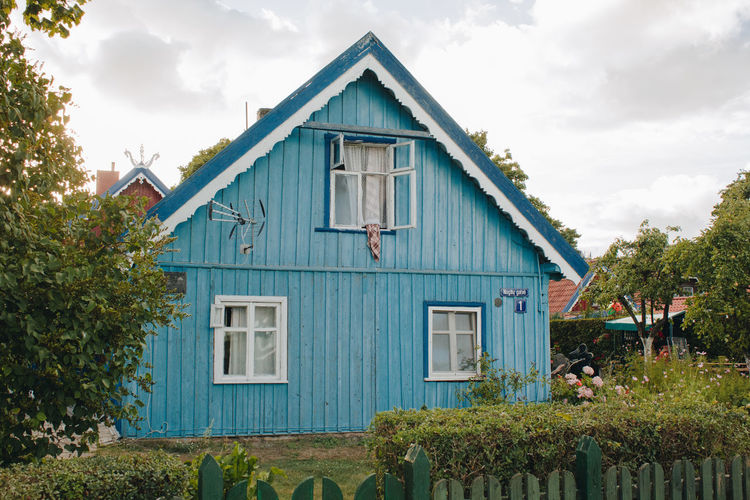 Lietuva Lithuania Architecture Blue Building Building Exterior Built Structure Cloud - Sky Cottage Day Front Or Back Yard Green Color Growth House Nature Nida No People Outdoors Plant Residential District Sky Tree Window Wood - Material