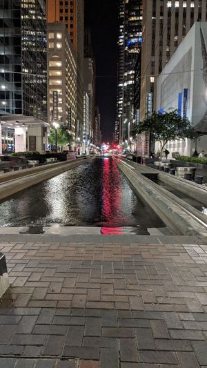 Main St at Night in Downtown Houston, TX Main Street Downtown Downtown Houston Houston Htown Htx Texas Night Nightphotography Night Photography Water Buildings Architecture Railway Travel Travel Photography Travel Blogger Good Times Followme Pixelxl2 City Illuminated Water Cityscape Architecture Building Exterior Built Structure Sky