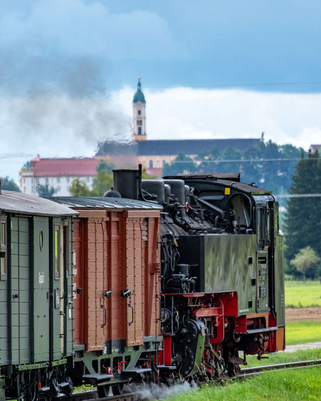 Train on field against sky