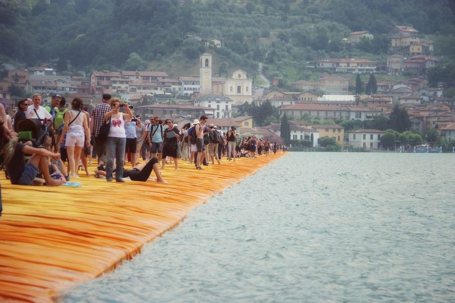 Walking on the Floating piers | Original Experiences People The Floating Piers Getting Inspired The Essence Of Summer Christo And The Floating Piers Point Of View Sunshine 43 Golden Moments Golden Moments  Feel The Journey Tailored To You Lago D'Iseo Showcase July EyeEm Italy |