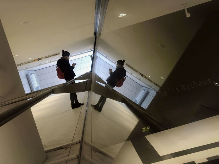 Low angle view of people walking on staircase in building