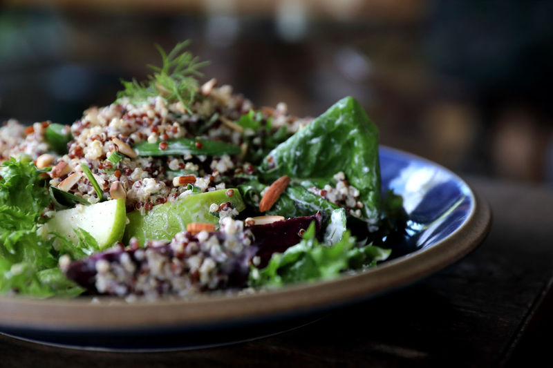 Quinoa salad with vegetable on wooden table Quinoa Salad Healthy Food Meal Bowl Vegan Dinner Fresh Vegetable Diet Lunch Background Cuisine Vegetarian Green Pepper Wooden Health Rustic Organic Plate Appetizer Eating Delicious Grain Tomatoes Gourmet Protein Super Lifestyle Nutrition Red Dish Spinach View Sweet Wood Tomato Closeup Healthy Eating Vegetarian Food