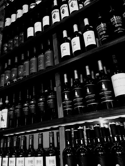 More variety Shelf Refreshment Indoors  Drink Bottle Arrangement No People Container Alcohol Side By Side In A Row Low Angle View Abundance Wine Bottle Wine Choice Large Group Of Objects Food And Drink