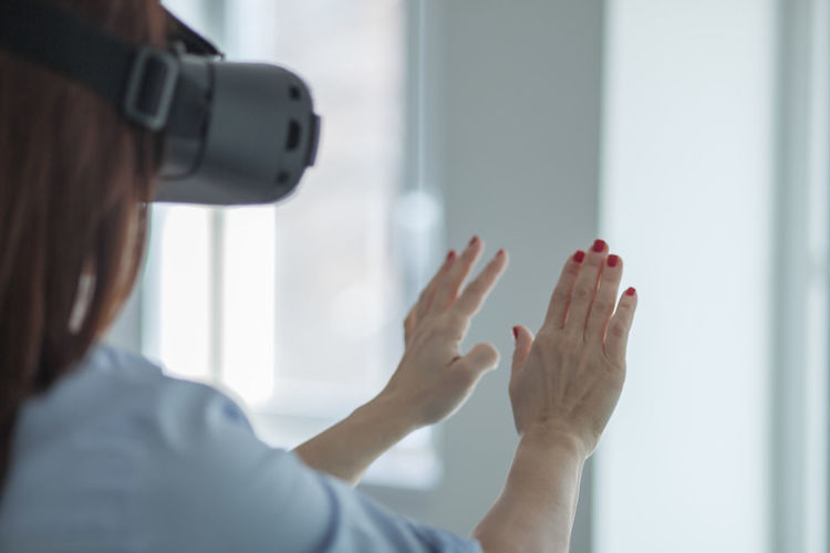 Mature woman using virtual reality simulator