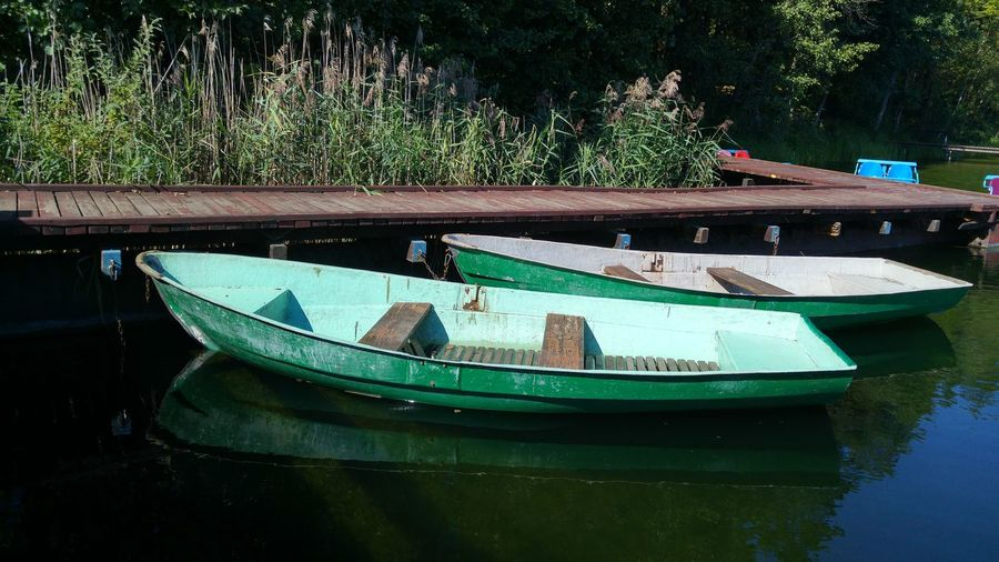 Two boats moored on lake